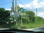 This is the signpost to Pointe Tarare (a naturist beach), as of January 2005. It seems to change every time we visit. We do not have the coordinates for this particular intersection; we do h ...